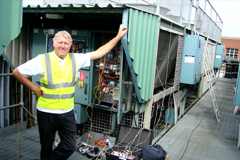 Swedish man in front of technical equipment. Photo.