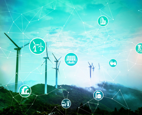 Photo of windmills and illustrated icons representing connectivity.