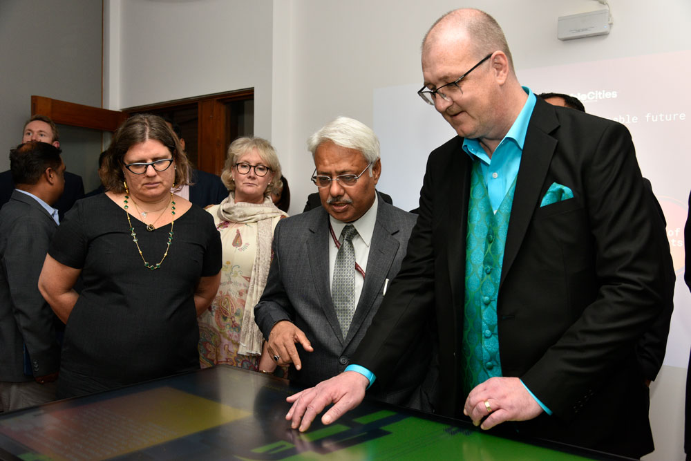 Ludvig Lindström demonstrating the showroom. Photo.