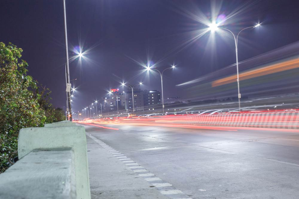 Road and streetlights at night. Photo.