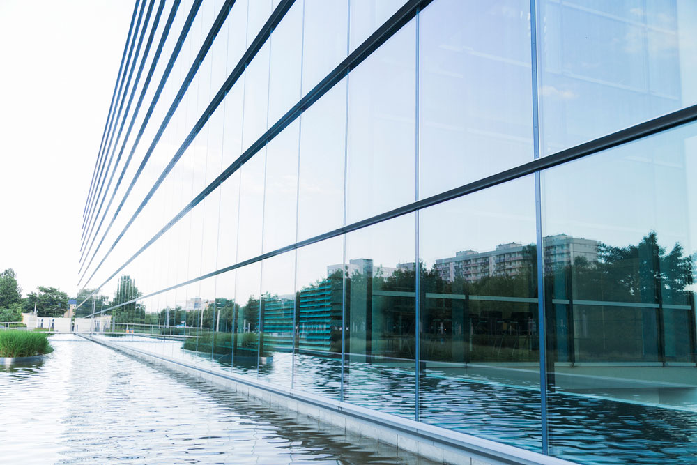 Glass front of a modern building. Photo.