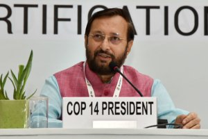 Prakash Javadekar speaking into a microphone. Photo.
