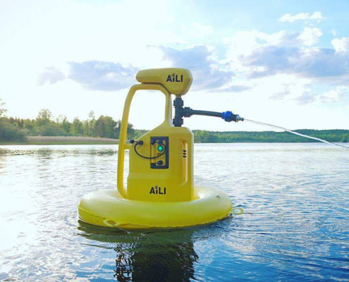 Yellow water pump in a lake. Photo.