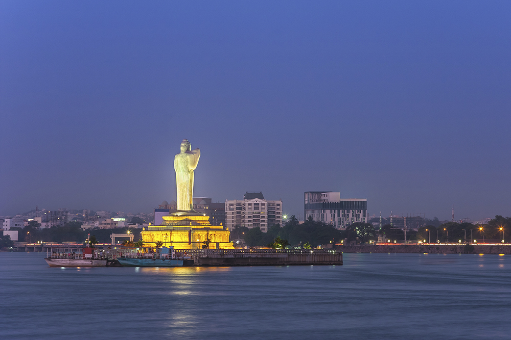 Statue of the Gautam Buddha in a lake in Hyderabad. Photo.