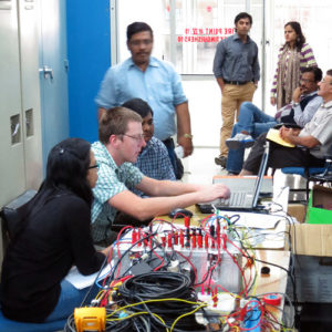 People working with technical equipment. Photo.
