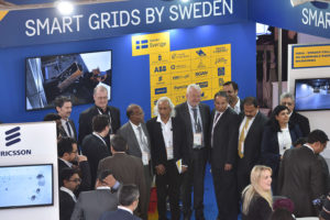 People at Sweden's stand. Photo.