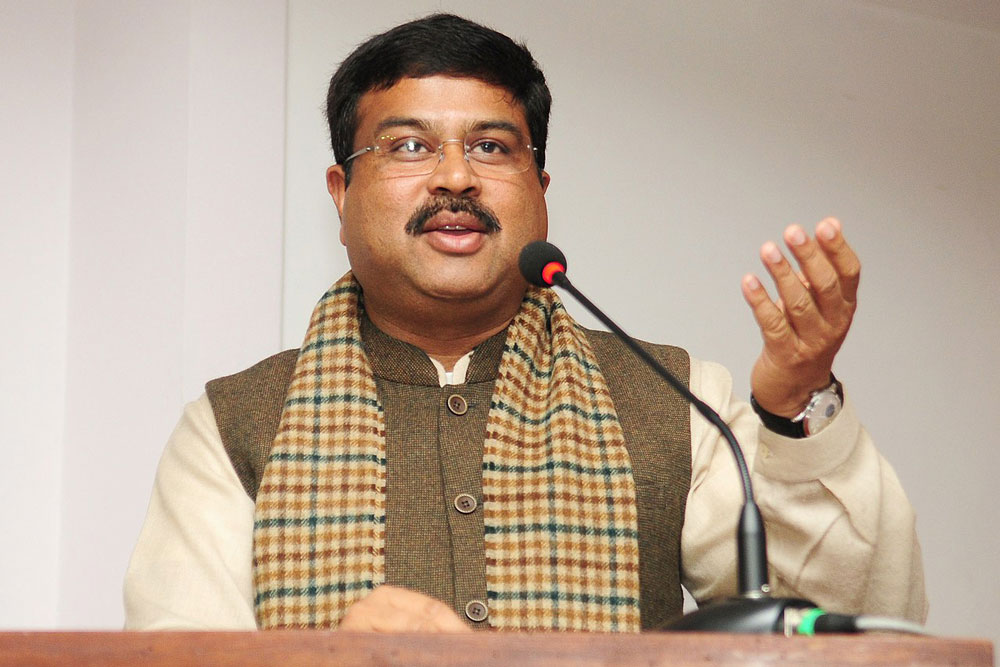 Dharmendra Pradhan speaking into a microphone. Photo.