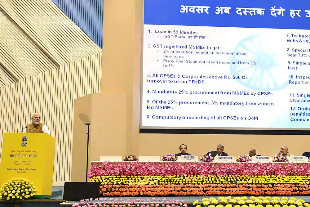 Narendra Modi on stage speaking. Photo.