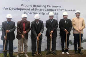 Six men in suits and helmets, digging. Photo.