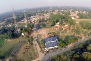 Solar panels in a rural village. Photo taken from above.