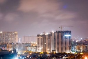 Night image of a city where high-rise buildings are being constructed. Photo.